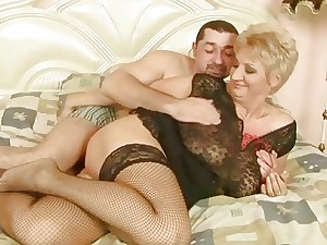 Grandma in fishnet stockings gets boned