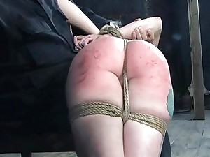 Confined girl is lifted up for her sexy torture