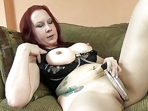 Lia Shayde fucks her snatch with a silver dildo