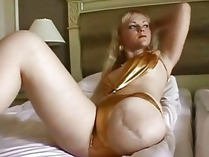 Blondie amputee peels off bikini and puts pantyhose and camisole on