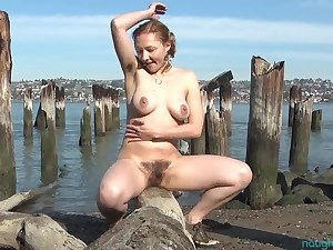 Highly hairy Maggie playing on a pier